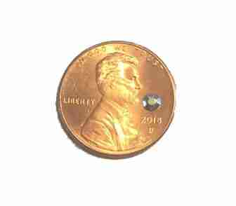 3mm silver iron on rhinestud shown for size on a penny